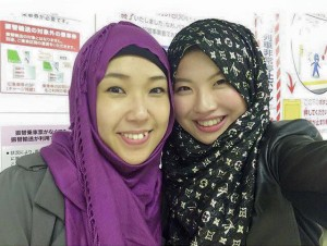 Risa-chan (left), with Arisa-chan after her shahada was taken.
